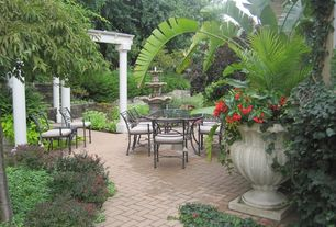 Traditional Patio with Fountain, Raised beds, exterior brick floors