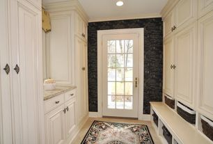 Traditional Mud Room with French doors, interior wallpaper, Concrete floors, Built-in bookshelf, Crown molding