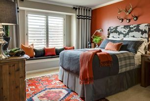 Traditional Guest Bedroom with Black Forest Decor Cowhide Headboard, Crown molding, Carpet