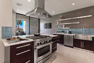 Contemporary Kitchen with Flush, two dishwashers, Farmhouse sink, European Cabinets, Subway Tile, L-shaped, Corian counters