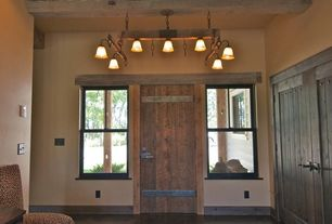 Country Entryway with Pendant light, Concrete floors