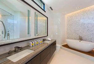 Modern Master Bathroom with Undermount sink, European Cabinets, Ms international arabescato carrara1x3 honed marble, Flush