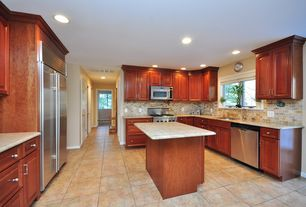 Traditional Kitchen with can lights, Flush, electric cooktop, full backsplash, Standard height, Raised panel, Stone Tile