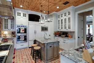 Country Kitchen with Breakfast bar, Kitchen island, can lights, built-in microwave, six panel door, Subway Tile, Flush