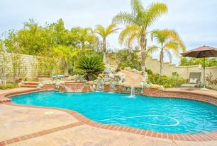 Mediterranean Swimming Pool with exterior brick floors, Fence