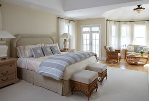 Traditional Master Bedroom with French doors, flush light, double-hung window, Transom window, High ceiling, Hardwood floors
