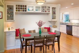 Cottage Dining Room with Built in wine storage, Glass panel cabinets, Hardwood floors, Bolla 4651br semi-flush light
