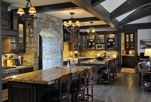 Traditional Kitchen with Breakfast bar, Glass panel, Kitchen island, Flush, Chandelier, U-shaped, Custom hood, Exposed beam
