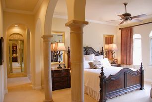 Traditional Master Bedroom with Arched window, Standard height, Ceiling fan, Crown molding, Carpet, Columns