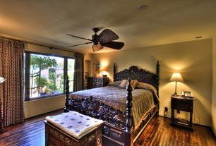 Mediterranean Guest Bedroom with Hardwood floors, Ceiling fan