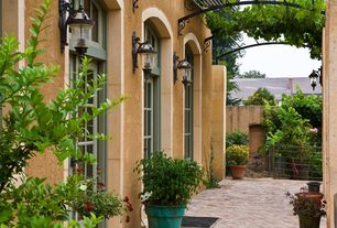 Mediterranean Patio with Deck Railing, Transom window, French doors, exterior brick floors, Pathway, Fence, Trellis