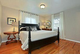 Modern Guest Bedroom with Hardwood floors, flush light