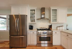 Modern Kitchen with gas range, Wall Hood, Simple granite counters, can lights, Ceramic Tile, Flat panel cabinets, Paint 1