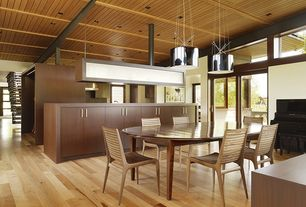 Contemporary Dining Room with can lights, High ceiling, Hardwood floors, Transom window, Pendant light, French doors