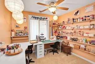 Traditional Home Office with Ceiling fan, Built-in bookshelf, Standard height, Carpet, Pendant light