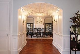 Traditional Dining Room with Laminate floors, Built-in bookshelf, Crown molding, Chandelier