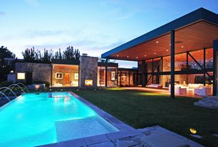 Contemporary Swimming Pool with exterior stone floors, Raised beds, outdoor pizza oven