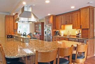 Craftsman Kitchen with KitchenCraft Cabinetry - Winfield in Cherry, Flush, Glass panel, Simple granite counters, U-shaped