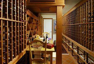 Craftsman Wine Cellar with terracotta tile floors, Columns, specialty door