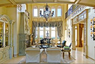 Traditional Living Room with Casement, Wall sconce, Cathedral ceiling, Laminate floors, Fireplace, Chandelier, Arched window