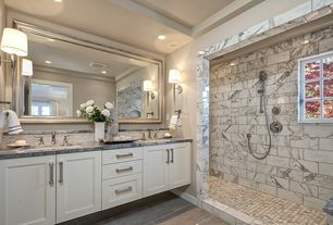 Traditional Master Bathroom with Master bathroom, Pental feel loft 12x24, specialty door, Complex Marble Tile, Wall sconce