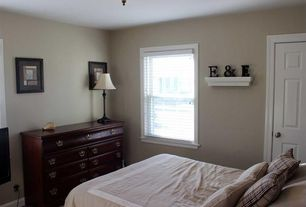 Traditional Master Bedroom with flush light, Carpet