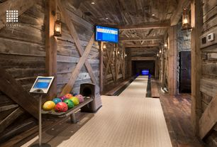 Rustic Game Room with Reclaimed wood, High ceiling, can lights, Cast horn lighting lantern wall sconce, Hardwood floors