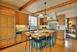 Mediterranean Kitchen with Kitchen island, Flat panel cabinets, Large Ceramic Tile, two dishwashers, mexican tile counters