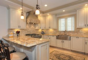 Traditional Kitchen with Wall Hood, U-shaped, Raised panel, Framed Partial Panel, stone tile floors, full backsplash, Paint