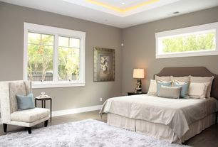 Traditional Master Bedroom with double-hung window, Hardwood floors, Standard height, can lights, picture window