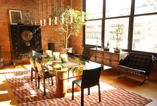 Eclectic Dining Room with High ceiling, Pendant light, Hardwood floors