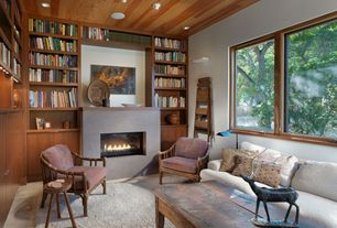 Rustic Library with can lights, limestone tile floors, Standard height, Casement, Built-in bookshelf, stone tile floors