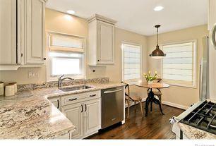 Traditional Kitchen with Hardwood floors, Butler Metalworks Adjustable Height Dining Table, Undermount sink, Raised panel