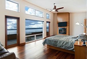 "Contemporary Master Bedroom with Hardwood floors, Ceiling fan, Black Walnut / Acacia / Standard / 3 5/8"", French doors"