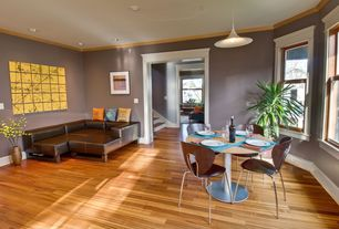 Contemporary Great Room with Crown molding, Hardwood floors, flush light