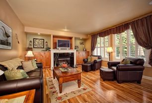 Craftsman Living Room with can lights, Casement, insert fireplace, Hardwood floors, Cement fireplace, metal fireplace