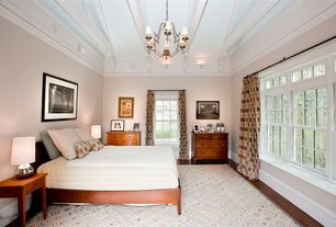 Modern Guest Bedroom with Laminate floors, Crown molding, Carpet, Wall sconce, Exposed beam, Chandelier