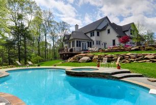 Traditional Swimming Pool with French doors, Fence, exterior stone floors, Pathway, Pool with hot tub