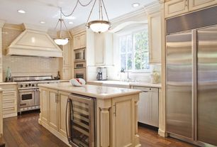 Traditional Kitchen with Custom hood, Wine refrigerator, double oven range, full backsplash, Laminate floors, Pendant light