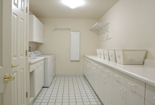 Traditional Laundry Room with stone tile floors, Undermount sink, Standard height, Prepac elite white cabinets, Paint