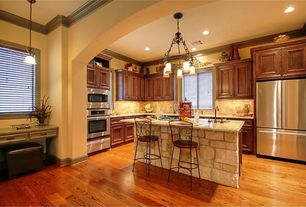 Traditional Kitchen with Undermount sink, Crown molding, Stone Tile, Chandelier, Hardwood floors, L-shaped, Raised panel