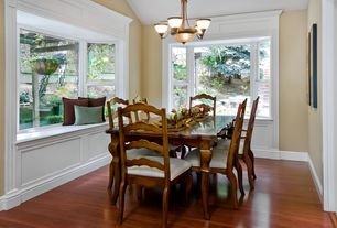 Traditional Dining Room with Hardwood floors, Bay window, Wainscotting, Chandelier, Window seat, High ceiling