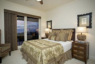 Tropical Guest Bedroom with French doors, Ceiling fan, Carpet, flush light, Crown molding