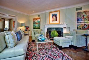Eclectic Living Room with Laminate floors, Standard height, Carpet, Fireplace, Casement, Crown molding, can lights