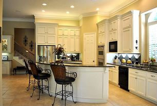 Traditional Kitchen with double wall oven, six panel door, High ceiling, Soapstone counters, Built In Refrigerator, U-shaped