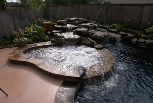 Mediterranean Hot Tub with Concrete floors, Pool with hot tub, Fence, Pool waterfall feature, Water feature