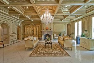 Traditional Living Room with Standard height, Box ceiling, French doors, can lights, Fireplace, Concrete tile , Chandelier