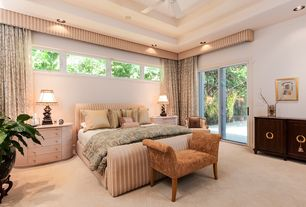 Traditional Master Bedroom with Ceiling fan, Casement, High ceiling, Carpet, sliding glass door, can lights