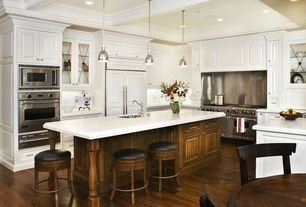 """Traditional Kitchen with Raised panel, Glass panel, Complex Marble, Viking professional 5 series 60"""" gas range, Breakfast bar"""
