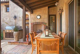 Mediterranean Porch with exterior brick floors, outdoor pizza oven, Outdoor kitchen